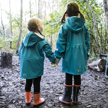 two girls in Grass & Air turquoise rain mac and wellies