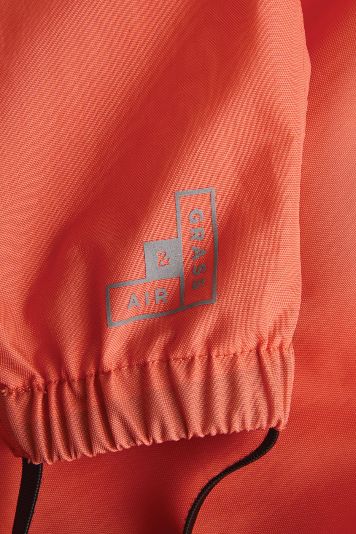 kids puddle suit reflective logo and elasticated foot stirrup detail