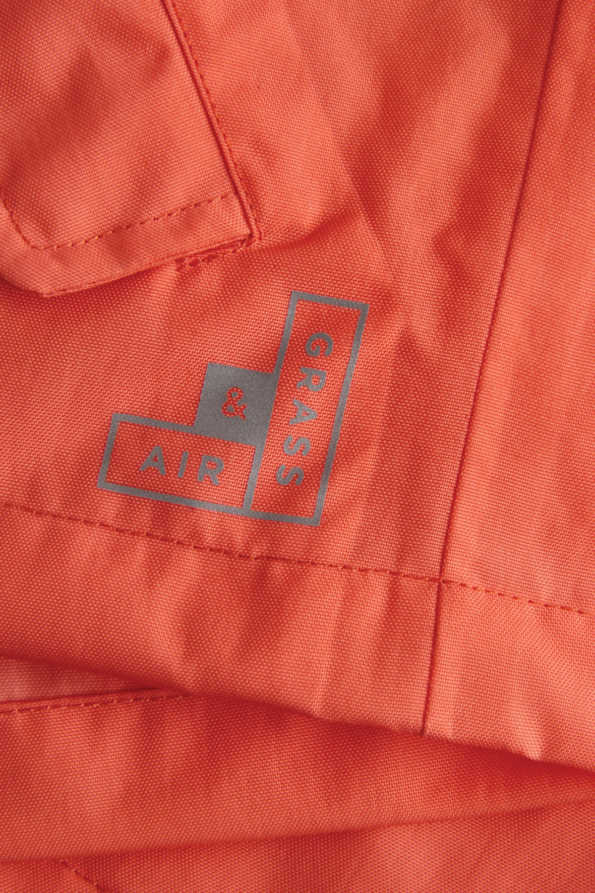 childrens coral rain jacket reflective logo detail
