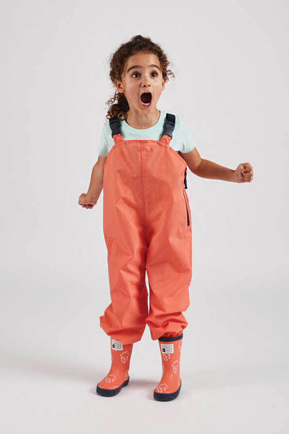 kids coral waterproof wader trousers lifestyle front view
