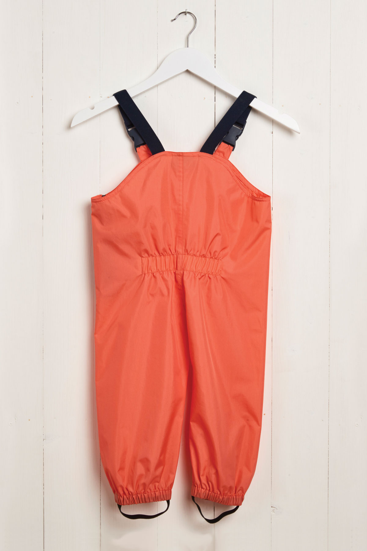 rear product view of kids coral waterproof dungarees