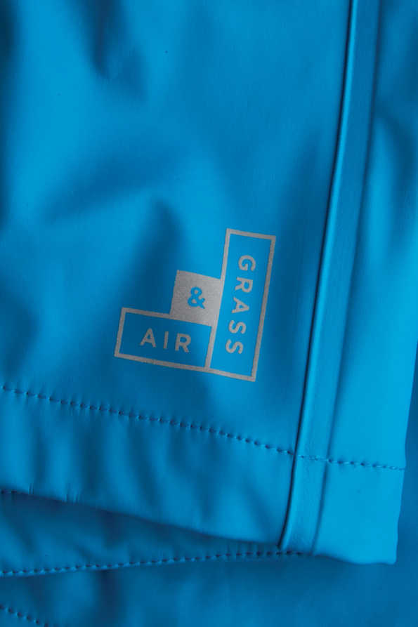 girls turquoise rain mac reflective logo detail