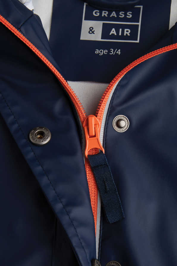 boys navy rain mac zip and storm flap detail