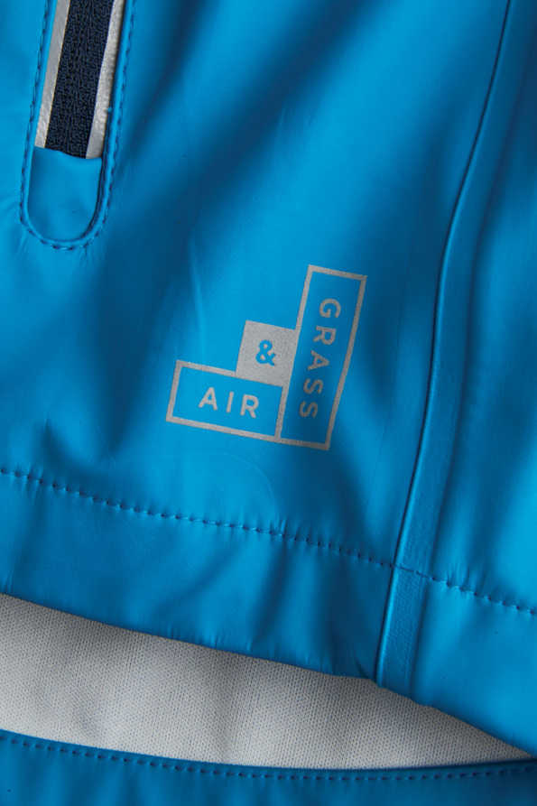 boys turquoise rainster reflective logo detail