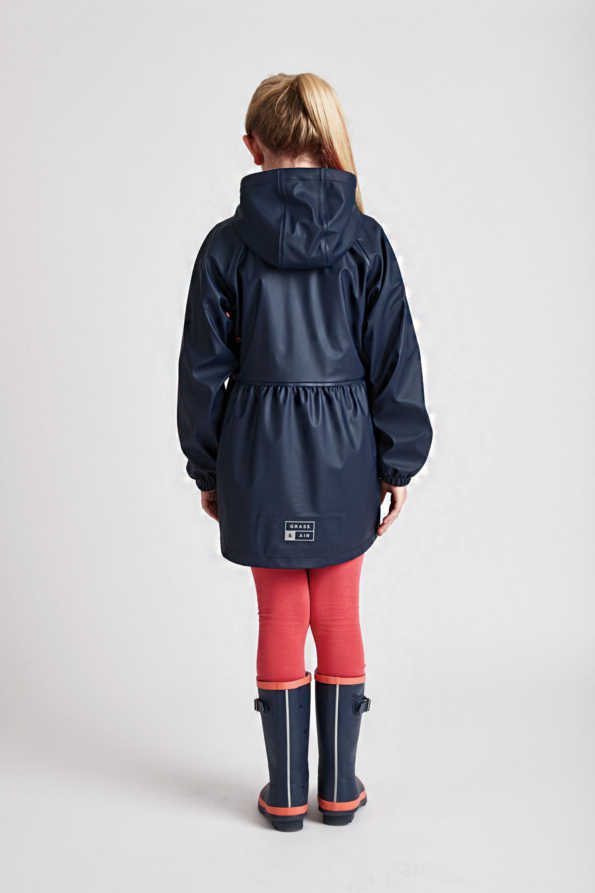 navy girls rain mac: Grass & Air girl navy Rainster rear product lifestyle view