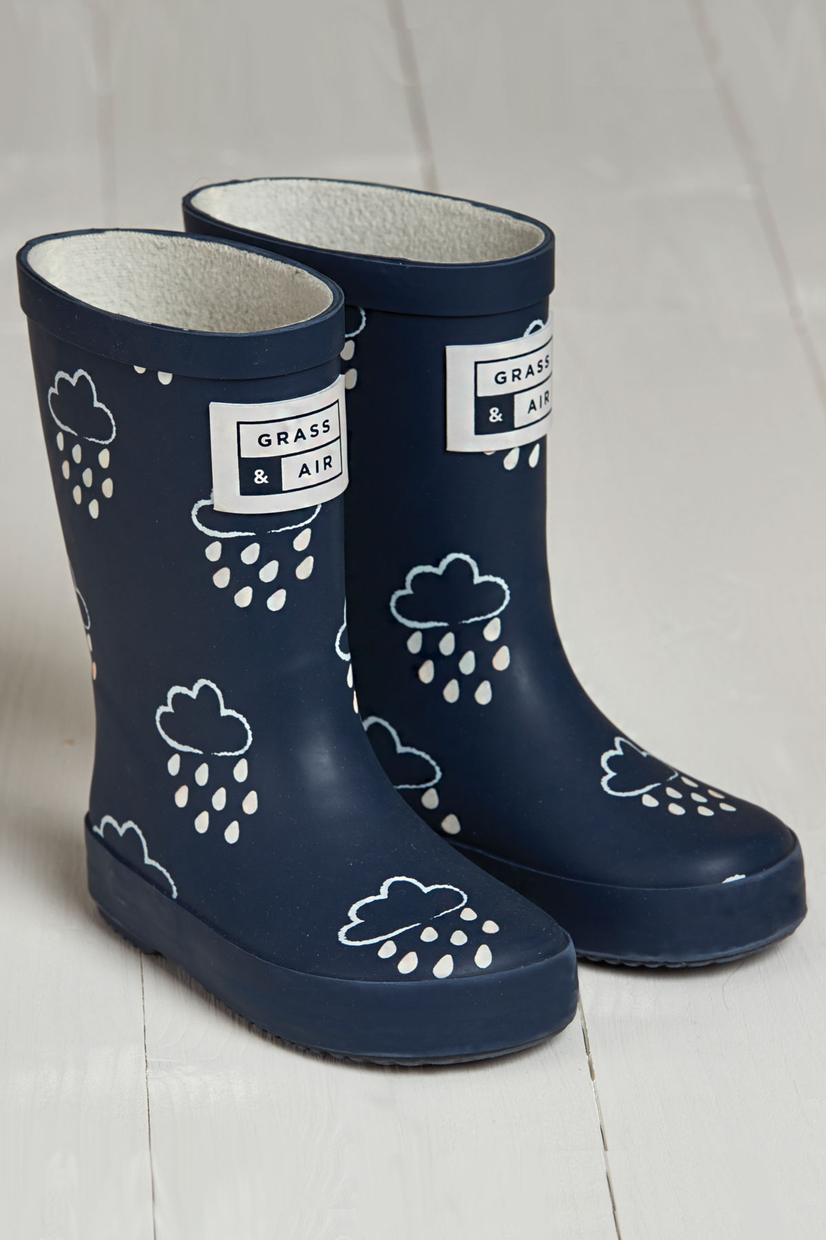 product shot of infant navy colour revealing wellies