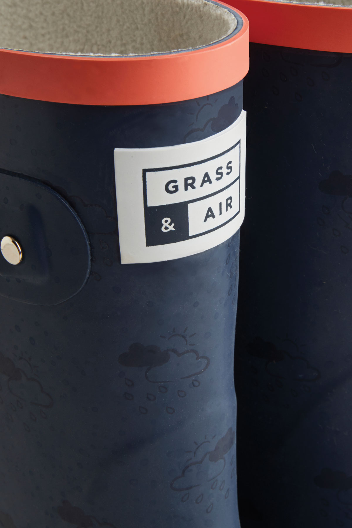 navy and coral junior wellies grass and air logo detail
