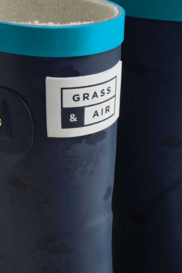 older kids navy and turquoise wellies grass and air logo detail
