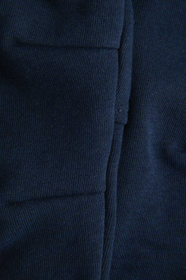 childrens navy jogging bottoms knee shape detail