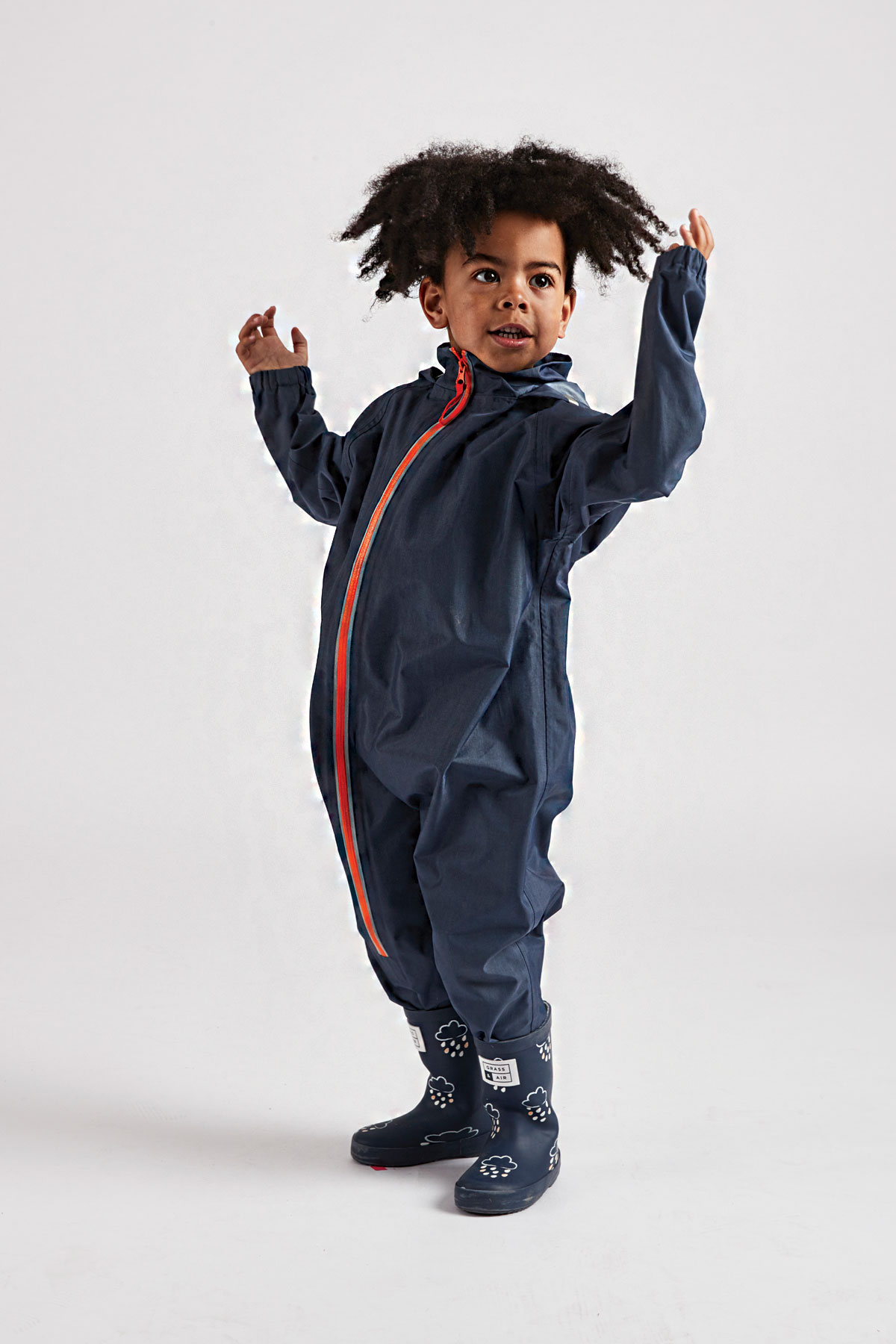 Grass & Air navy stomper suit: kids all in one waterproof suit - lifestyle side view