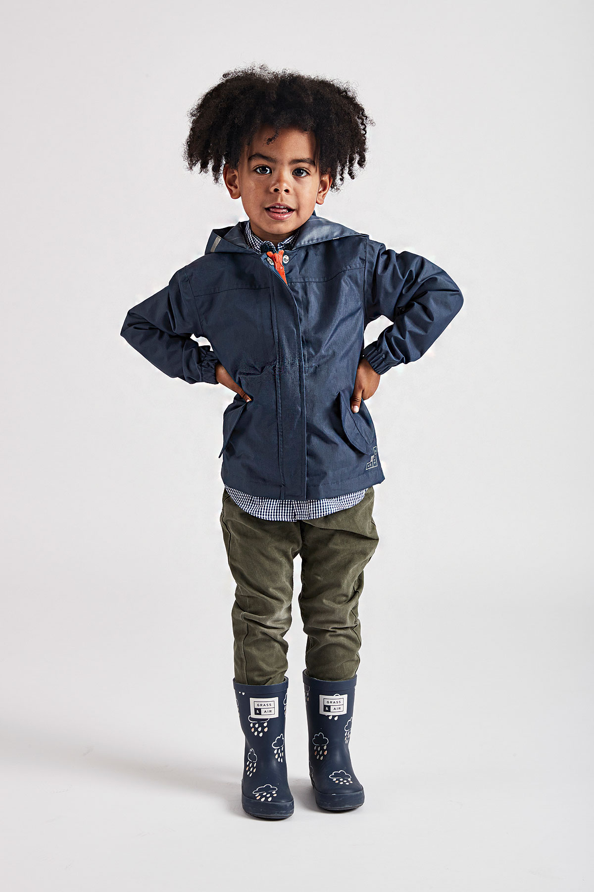 kids infant navy raincoat with orange contrast zip - front product lifestyle view