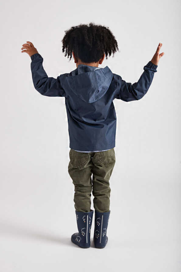 children's navy rain jacket - product lifestyle rear view
