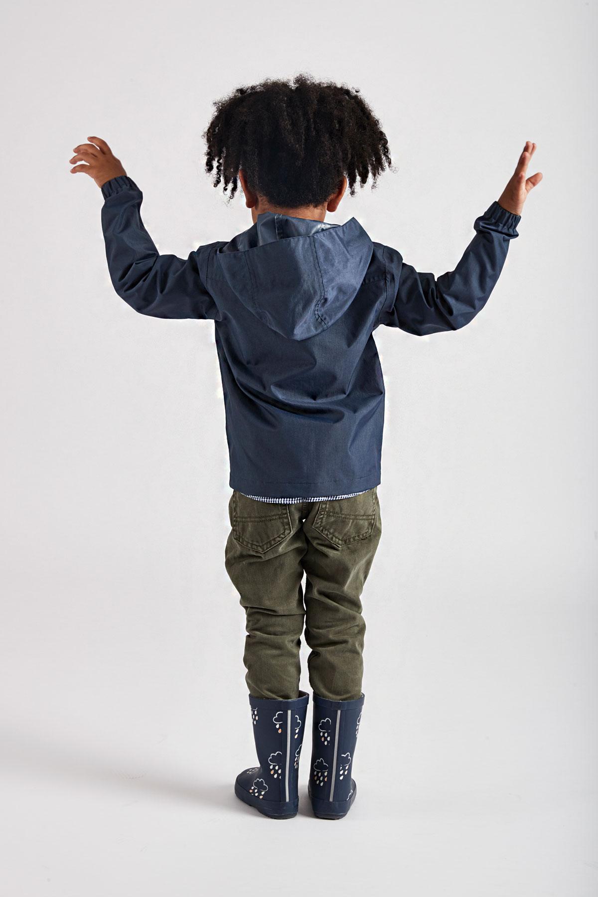 children's navy rain jacket - product lifestyle rear view