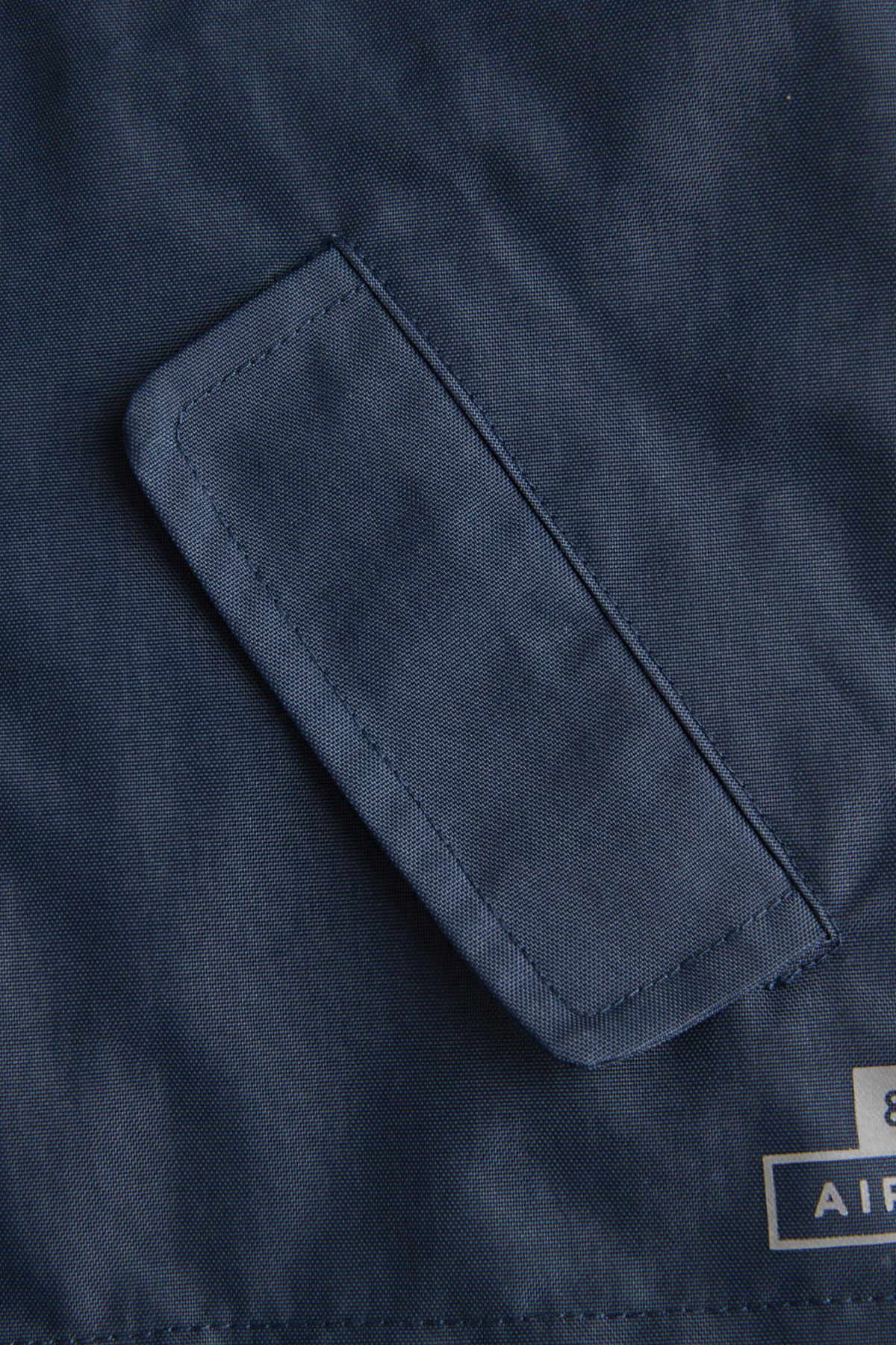 infant navy rain jacket pocket detail