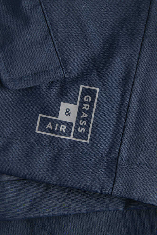 navy rain cheater reflective logo detail