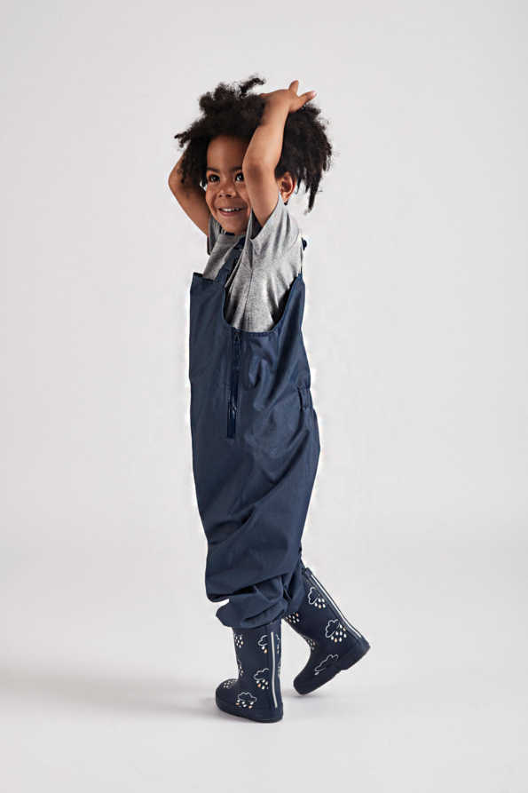 kids navy stomper slacks lifestyle side view
