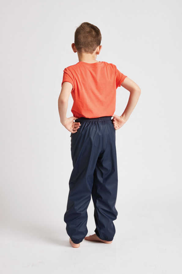kids unisex waterproof trousers in navy: rear product view