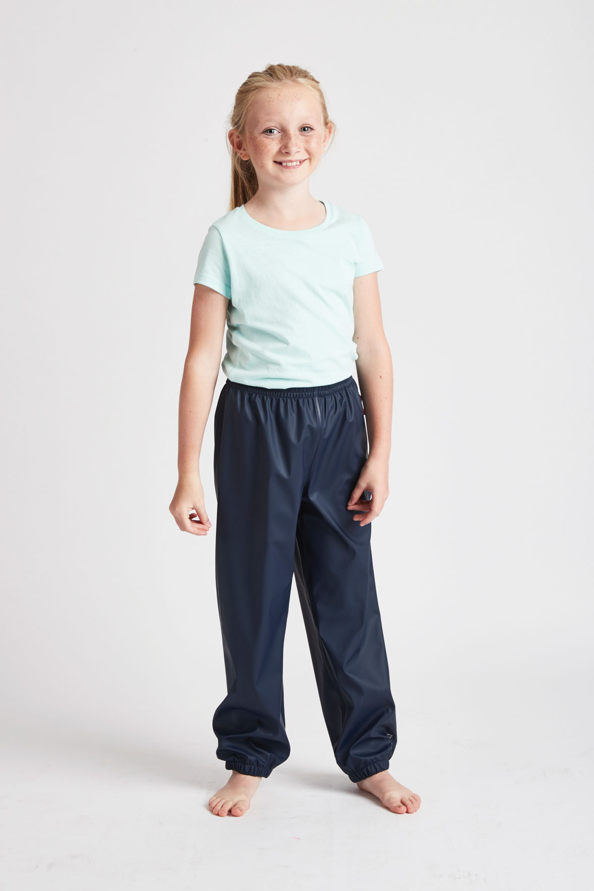 unisex kids navy waterproof trousers: front product lifestyle view