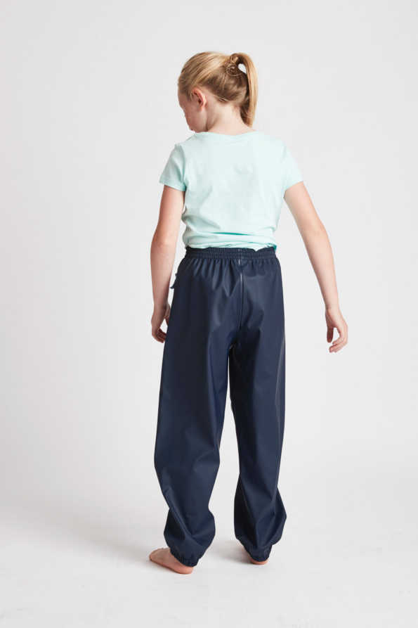 kids waterproof trousers: unisex navy waterproof pants for kids - rear product view