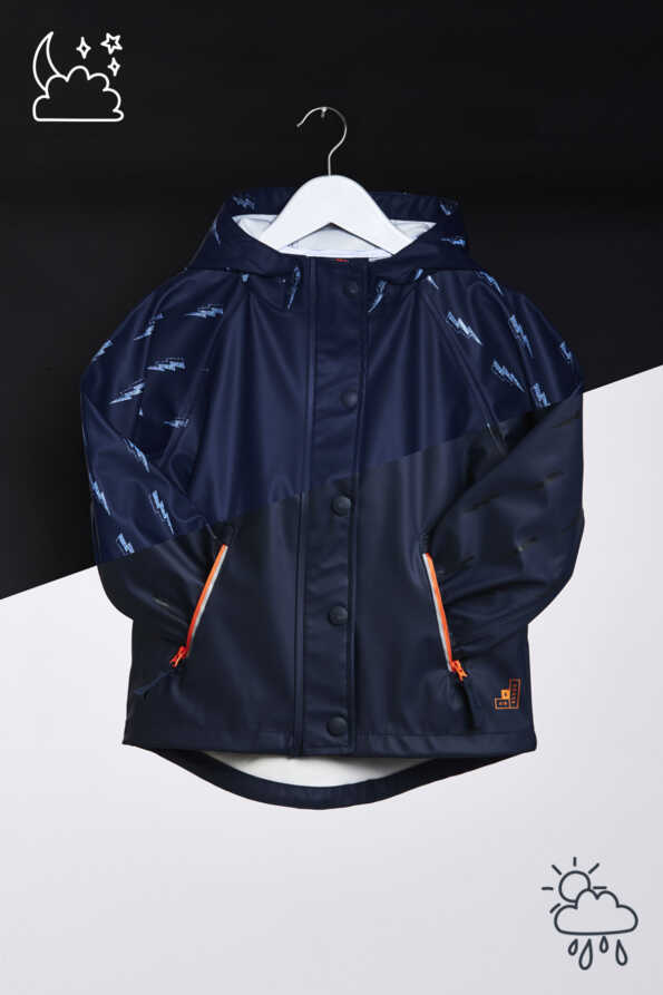 """Light Catcher"" reflective rain mac with lightning bolt reflective pattern. Day vs night pattern comparison detail"