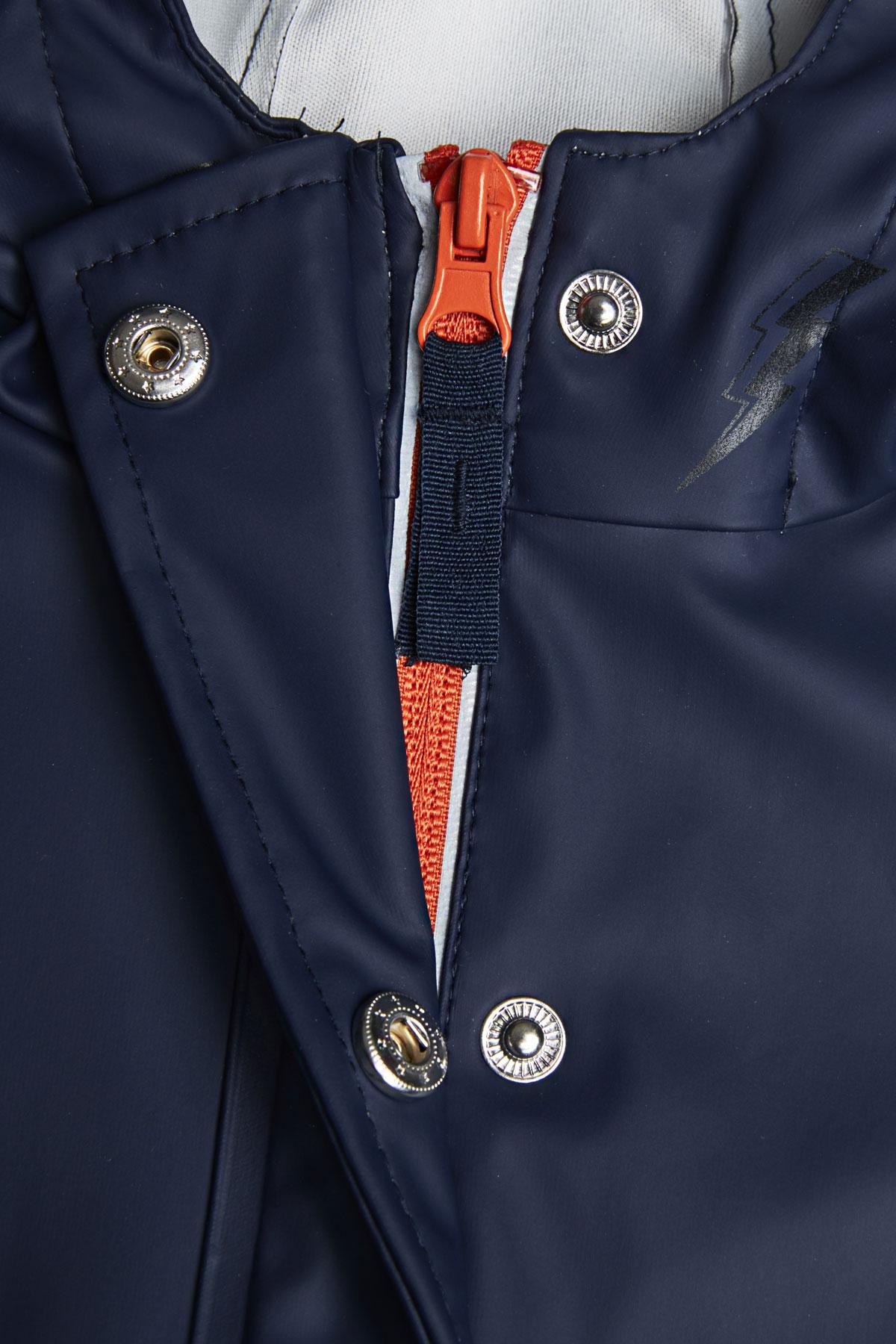 reflective light catcher rain mac zip and press stud detail