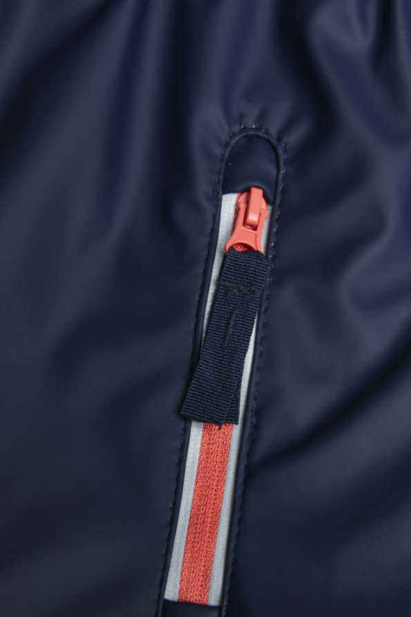 girls navy raincloud reflective rain mac: coral and reflective pocket zip detail